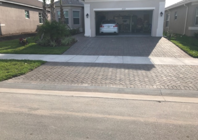 Cleaned, sanded, and sealed this Paver driveway in Wimauma protecting it from UV Ray damage.