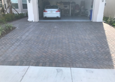 Cleaned, sanded, and sealed this Paver driveway in Wimauma protecting it from UV Ray damage. 1