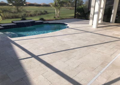 Travertine patio cleaned,sanded, and sealed adding a non slip additive